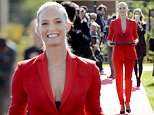 Israeli model Bar Refaeli brings the scissors for the ribbon cutting ceremony during the inauguration ceremony of an extension of the manufacture of the Swiss luxury watchmaker Hublot, owned subsidiary of France's LVMH, in Nyon, Switzerland, Tuesday, Sept. 29, 2015. (Laurent Gillieron/Keystone via AP)