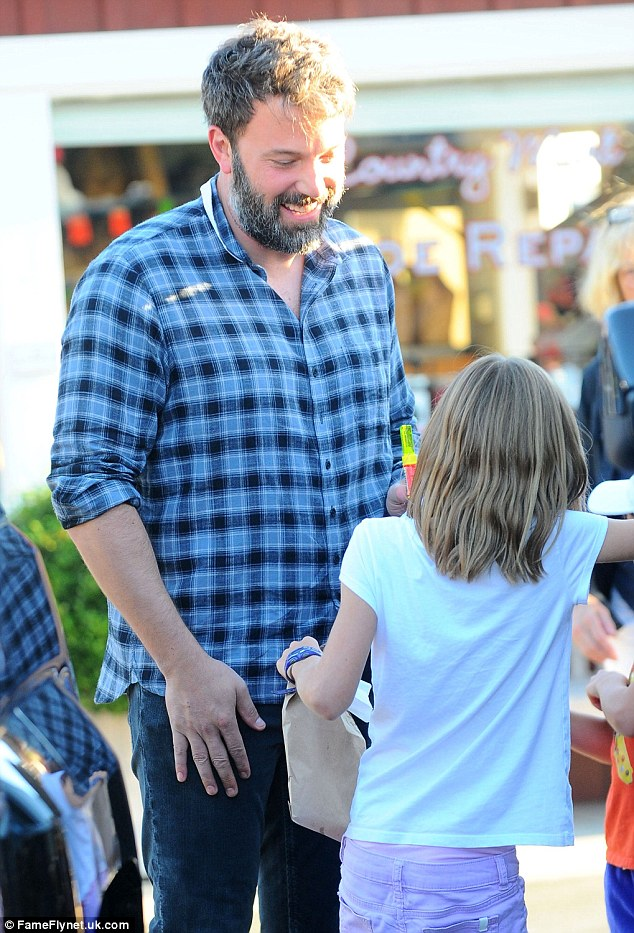 In good spirits: Ben was seen cracking a smile as he chatted with his daughters