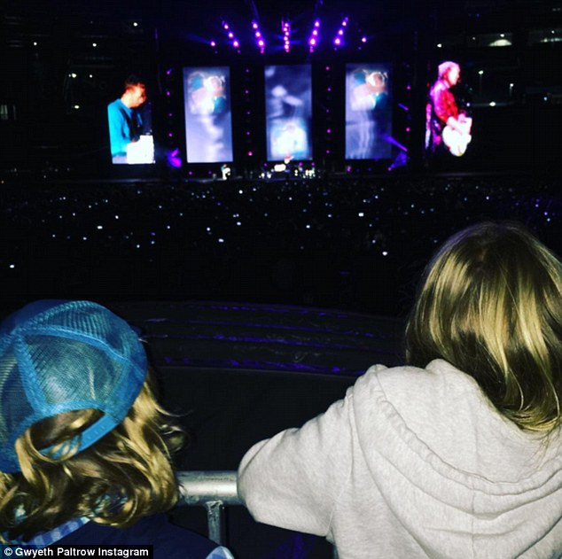 That's my dad! Apple, 11, and Moses, nine, went with mom Gwyneth Paltrow to see dad Chris Martin in concert with Ed Sheeran in the Boston area on Friday night