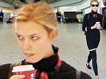 29.SEPTEMBER.2015 - LONDON - UK\n***EXCLUSIVE ALLROUND PICTURES***\nMODEL KARLIE KLOSS LOOKS A LITTLE TIRED AS SHE'S PICTURED PICKING UP A COFFEE WHILE ARRIVING AT HEATHROW AIRPORT IN LONDON.\nBYLINE MUST READ : XPOSUREPHOTOS.COM\n***UK CLIENTS - PICTURES CONTAINING CHILDREN PLEASE PIXELATE FACE PRIOR TO PUBLICATION***\nUK CLIENTS MUST CALL PRIOR TO TV OR ONLINE USAGE PLEASE TELEPHONE 0208 344 2007