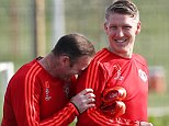 Wayne Rooney laughs with Bastian Schweinsteiger of Manchester United during training at Carrington, Manchester