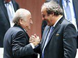 UEFA President Michel Platini (R) congratulates FIFA President Sepp Blatter after he was re-elected at the 65th FIFA Congress in Zurich, Switzerland, in this file picture taken May 29, 2015. Swiss prosecutors have opened a criminal investigation into Blatter, the head of world soccer body FIFA, on suspicion of criminal mismanagement and misappropriation, the Swiss attorney general's office said on September 25, 2015.       REUTERS/Arnd Wiegmann/Files TPX IMAGES OF THE DAY - RTR4Y2C8      TPX IMAGES OF THE DAY