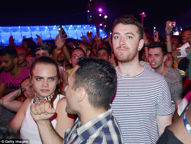 A-list: Cara Delevingne and Sam Smith watched Rihanna perform at Rock in Rio in Brazil on Saturday night