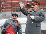 An impersonator of Soviet leader Josef Stalin (R) waves while standing near an impersonator of Soviet leader Vladimir Lenin (L) in central Moscow on March 5, 2010. Supporters of the Communist party paid their respects to Stalin at his grave near the Kremlin wall on Red Square to mark the 57th anniversary of his death.     AFP PHOTO / NATALIA KOLESNIKOVA (Photo credit should read NATALIA KOLESNIKOVA/AFP/Getty Images)