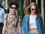 Picture Shows: Annie Clark, St. Vincent, Cara Delevingne  September 28, 2015    Model Cara Delevingne and her girlfriend, singer Annie Clark aka St. Vincent, are spotted out for a stroll together in New York City, New York. Cara recently returned from Brazil where she enjoyed a getaway with singer Rihanna.    Non Exclusive  UK RIGHTS ONLY    Pictures by : FameFlynet UK © 2015  Tel : +44 (0)20 3551 5049  Email : info@fameflynet.uk.com