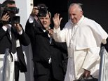 Official Vatican photographers record Pope Francis as he waves before boarding his plane at Andrews Air Force Base, Md., Thursday, Sept. 24, 2015, en route to New York. (AP Photo/Jacquelyn Martin)
