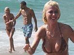 EXCLUSIVE: September 27th 2015 - Tara Reid spends the day at the beach with her boyfriend in Malibu, California.\n\nPictured: Tara Reid \nRef: SPL1137889  270915   EXCLUSIVE\nPicture by: Ability Films / Splash News\n\nSplash News and Pictures\nLos Angeles: 310-821-2666\nNew York: 212-619-2666\nLondon: 870-934-2666\nphotodesk@splashnews.com\n