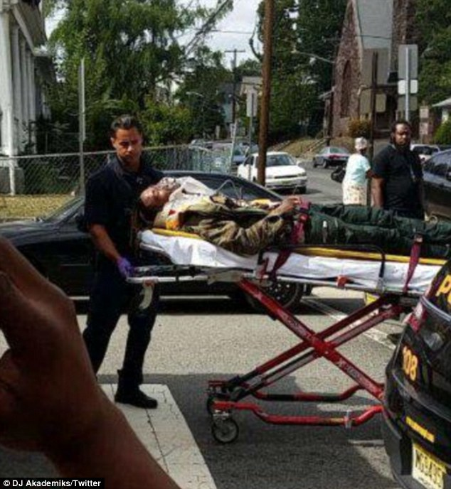 On a stretcher: The musician was seen strapped down with an oxygen mask on his face