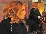 29 SEP 2015 - LONDON - UK\n*** EXCLUSIVE ALL ROUND PICTURES ***\nELUSIVE SINGER ADELE WHO IS RUMOURED TO BE RELEASING A NEW ALBUMN SOON WAS SPOTTED AT ROKA RESTAURANT. THE DIVA WORE ALL BLACK FOR THE OCCASION AND SEEMED TO HAVE A SCREENSAVER OF HER SON ANGELO ON HER PHONE, SHE DINED FOR 2 HOURS BUT HER PARTNER  SIMON WAS NOT PRESENT!\nBYLINE MUST READ : XPOSUREPHOTOS.COM\n***UK CLIENTS - PICTURES CONTAINING CHILDREN PLEASE PIXELATE FACE PRIOR TO PUBLICATION ***\n**UK CLIENTS MUST CALL PRIOR TO TV OR ONLINE USAGE PLEASE TELEPHONE   44 208 344 2007 **