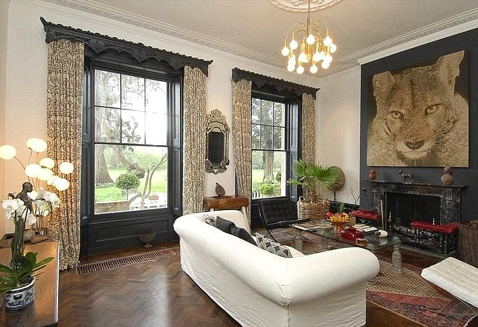 This is one of the main living areas in the multi-million pound house in Berkshire, which has grand open windows and traditional fireplaces