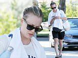 143045, EXCLUSIVE: A ringless Kaley Cuoco spotted leaving her 2 hour long yoga class in LA. The actress has filed for divorce from husband Ryan Sweeting after 21 month of marriage and revealed she has a pre-nup in place. Los Angeles, California - Tuesday September 29, 2015. Photograph: Sam Sharma, © PacificCoastNews. Los Angeles Office: +1 310.822.0419 sales@pacificcoastnews.com FEE MUST BE AGREED PRIOR TO USAGE