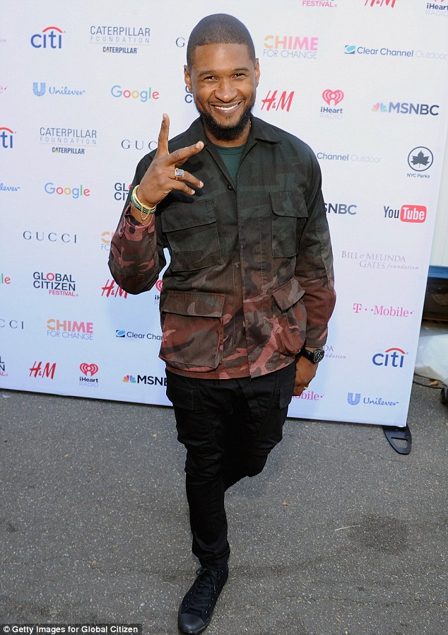 Handsome: Usher also attended the event in camouflage army jacket, black jeans and black Chuck Taylor shoes