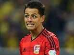 Leverkusen's Mexican striker Javier Hernandez reacts during the German first division Bundesliga football match Borussia Dortmund vs Bayer Leverkusen in Dortmund, western Germany on September 20, 2015. Dortmund won the match 3-0.   AFP PHOTO / PATRIK STOLLARZ RESTRICTIONS: DURING MATCH TIME: DFL RULES TO LIMIT THE ONLINE USAGE TO 15 PICTURES PER MATCH AND FORBID IMAGE SEQUENCES TO SIMULATE VIDEO.  == RESTRICTED TO EDITORIAL USE ==  FOR FURTHER QUERIES PLEASE CONTACT DFL DIRECTLY AT + 49 69 650050.PATRIK STOLLARZ/AFP/Getty Images