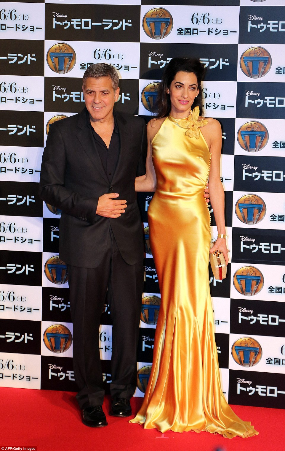 George and Amal Clooney pose for a picture on the red carpet at the Japan premiere of his movie Tomorrowland in Tokyo in May this year