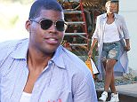 Picture Shows: EJ Johnson  September 29, 2015    Reality star EJ Johnson and some friends spotted out shopping in West Hollywood, California. EJ looked stylish in a long coat and denim shorts.    Non Exclusive  UK RIGHTS ONLY    Pictures by : FameFlynet UK © 2015  Tel : +44 (0)20 3551 5049  Email : info@fameflynet.uk.com