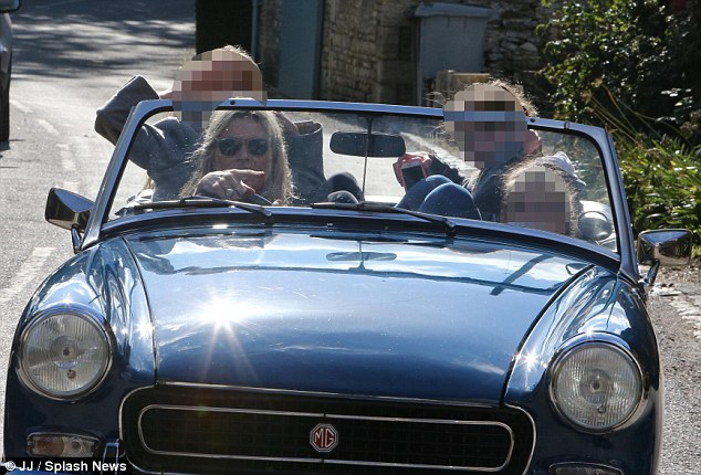 Make way: The pretty blonde was seen driving her family to her local pub