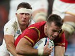England's Richard Wigglesworth fails to stop Wales' Gareth Davies from scoring Wales' only try of the match