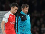 LONDON, ENGLAND - SEPTEMBER 29: Injured Arsenal defender Laurent Koscielny walks off the pitch with physio Colin Lewin during the UEFA Champions League match between Arsenal and Olympiacos at Emirates Stadium on September 29, 2015 in London, United Kingdom. (Photo by Stuart MacFarlane/Arsenal FC via Getty Images)