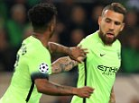 Manchester City's Nicolas Otamendi (right) celebrates scoring his side's first goal of the game with teammate Raheem Sterling (left)