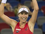 Johanna Konta of Great Britain reacts after she defeats Simona Halep of Romania during the women's singles match on day three of the Wuhan Open tennis tournament in Wuhan, in China's Hubei province on September 30, 2015. AFP PHOTO / FRED DUFOURFRED DUFOUR/AFP/Getty Images