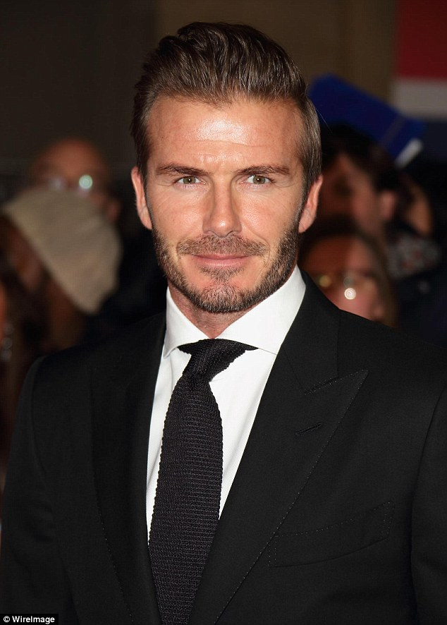 Golden Balls: Beckhamslicked his hair back in its usual quiffed style and continued to rock his designer beard
