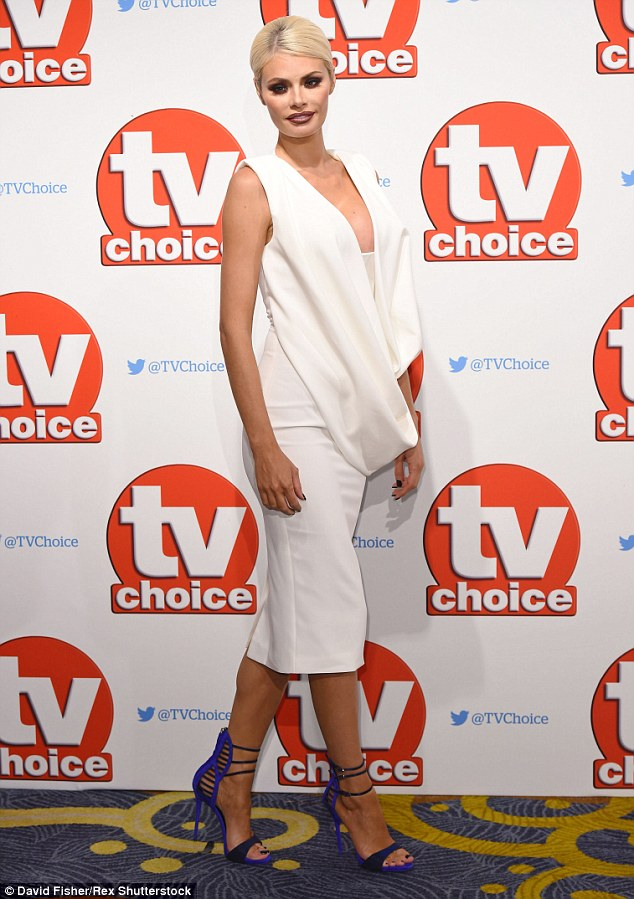 All white on the night!Chloe Sims amped up the sex appeal in a plunging number and bold blue heels