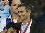GELSENKIRCHEN, GERMANY - MAY 26:  Nuno Valente of FC Porto hugs his manager Jose Dos Santos Mourinho after winning the Champions League during the UEFA Champions League Final match between AS Monaco and FC Porto at the AufSchake Arena on May 26, 2004 in Gelsenkirchen, Germany.  (Photo by Alex Livesey/Getty Images) *** Local Caption *** Nuno Valente;Jose Dos Santos Mourinho