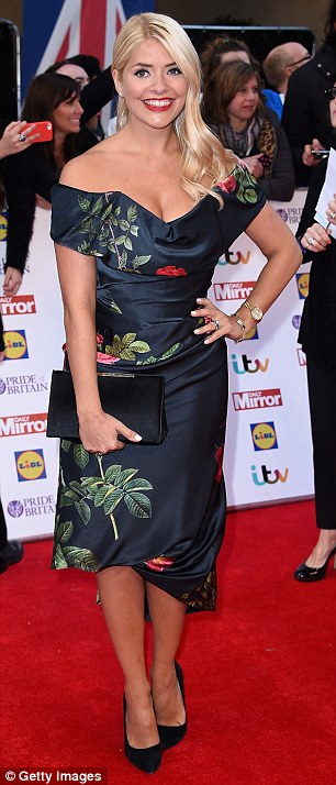Hard to miss: Holly did well to stand out in her ensemble as she donned a pair of black pointed heels