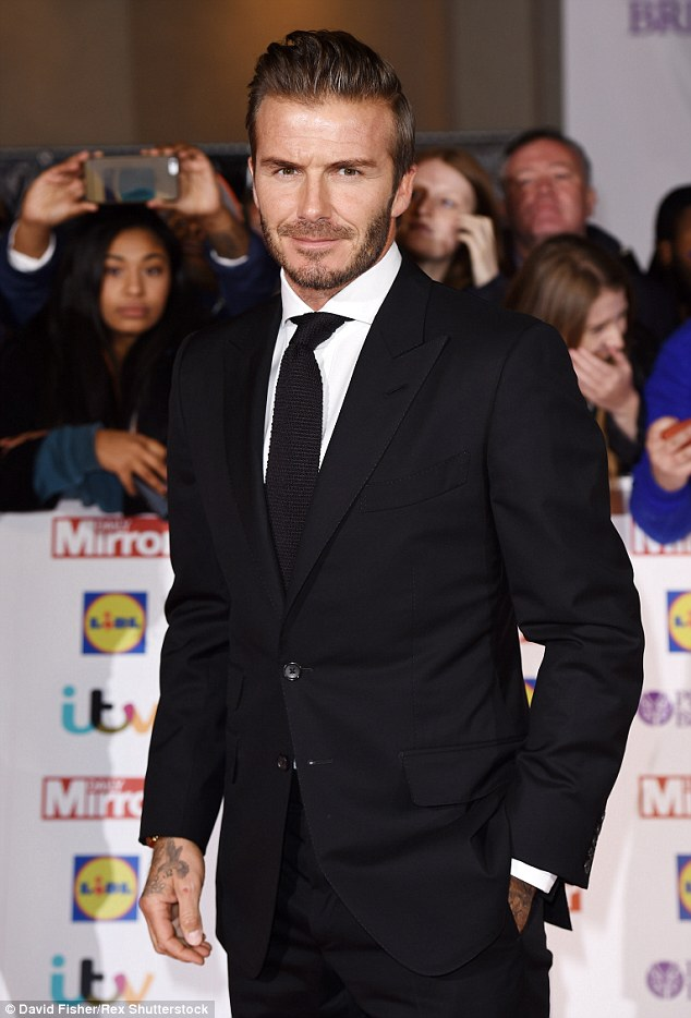 Sharp! The 40-year-old smouldered in a fitted black suit as he took to the red carpet at Grosvenor House Hotel