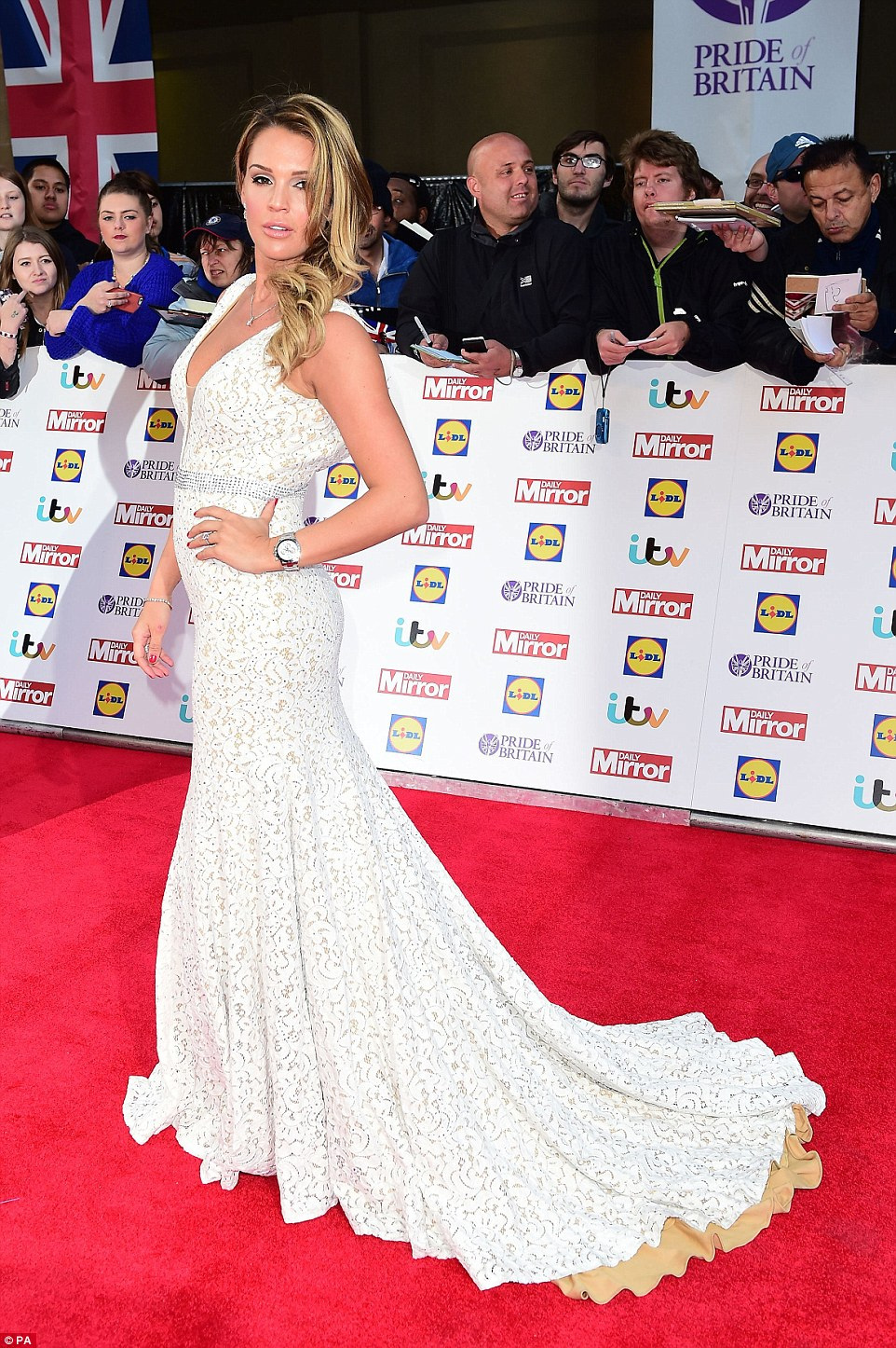 Turning heads: Danielle Lloydoozed heaps of elegance in a striking white gown, which boasted a plunging bodice and a fishtail skirt that highlighted her lean and slender frame to perfection