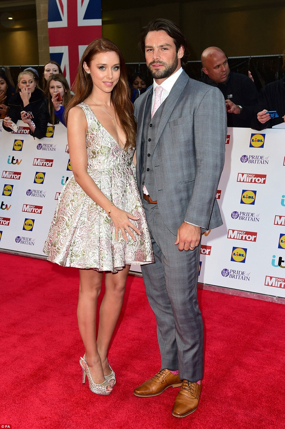 Pretty as a petal:Una Foden showed off her slim limbs in a cute floral dress as she attended the event with husband Ben