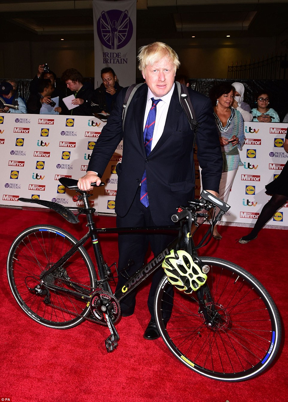Get on your bike: London mayor Boris Johnson put in a typically showy appearance - arriving on two wheels