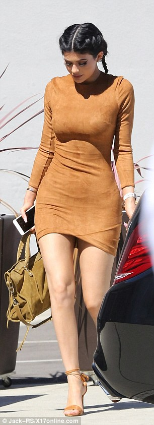 Fashion smarts: Kylie flashed her long legs in the skin tight dress