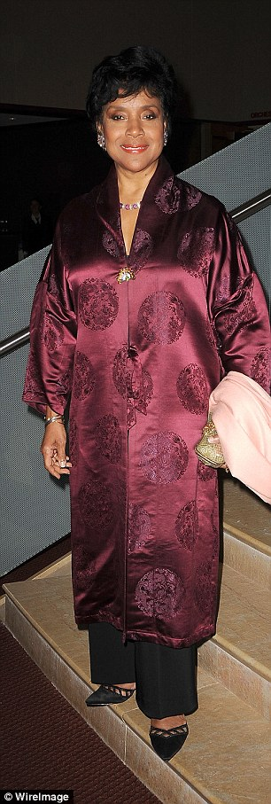 Who needs Bill? Cosby Show star Phylicia Rashad arrived in a silk kimono