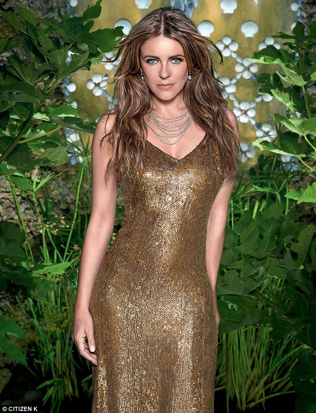 Brunette beauty:Former Austin Powers star Elizabeth also wows within the magazine, wearing a plunging gold sequinned dress, which flaunts her slim figure to perfection