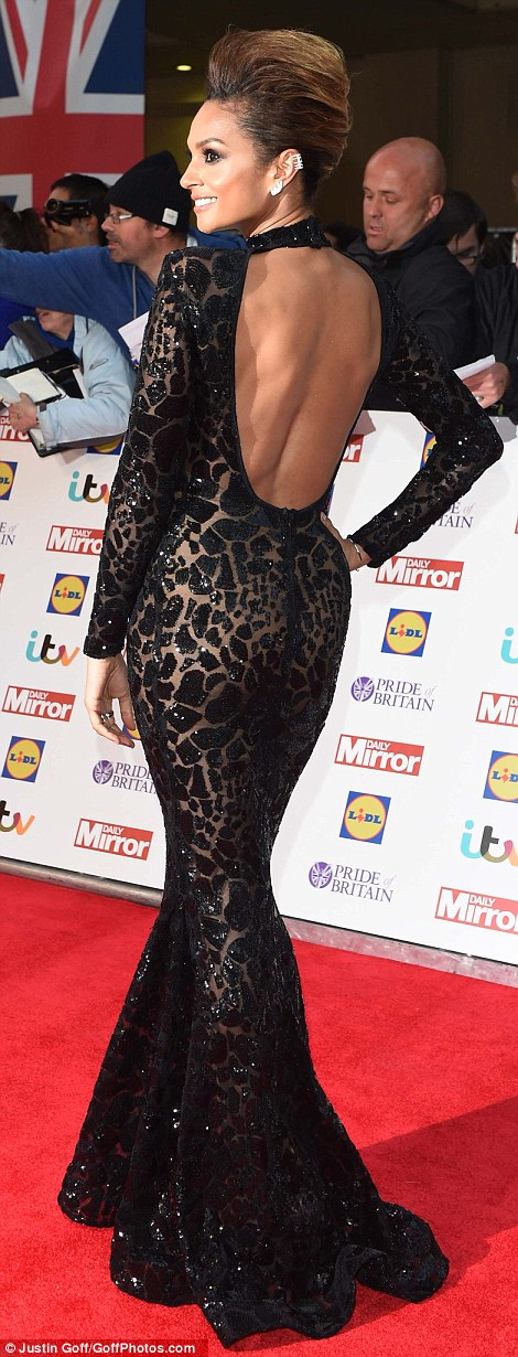 Lean and slender: She opted to show off her svelte figure in a dramatic, showstopping full-length black gown