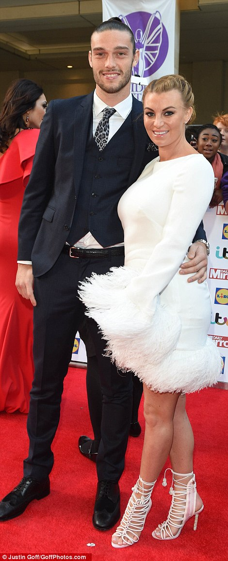 Fringe galore: New mum Billi Mucklow opted for a daring fluffy gown as she cuddled up to her footballer fiance Andy Carroll