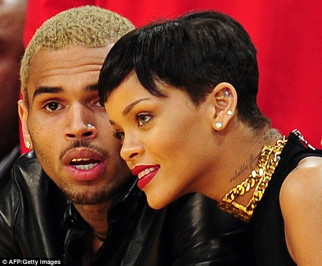 Rihanna and Chris attend a game between the New York Knicks and the Los Angeles Lakers in Los Angeles in December 2012