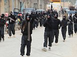 ISIS militants marching. Islamic State. no further info supplied