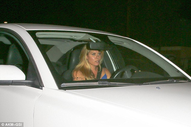 Blonde beauty: Candis was seen leaving the eatery in her white car