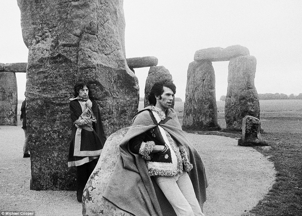 Mick Jagger and Keith Richards pose at Stonehenge in 1967 in capes and fashion that reflects the psychedelic era