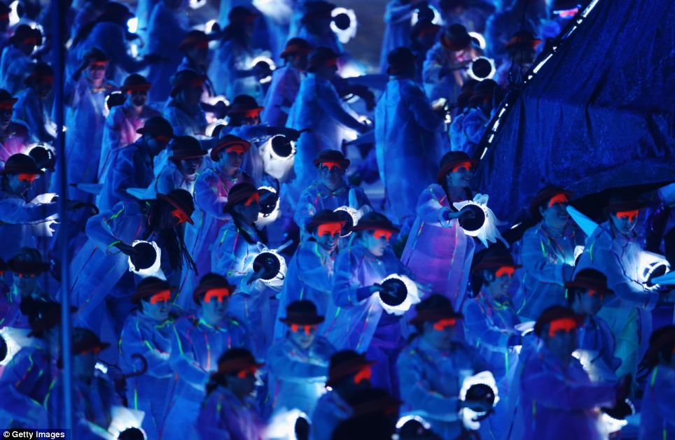 Impressive: As the stadium turned dark, the performers held lights with provided a stunning contrast