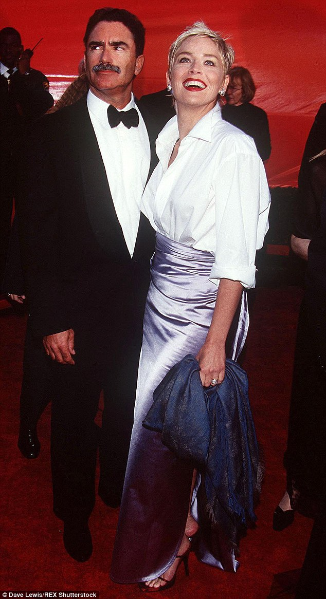 Looks familiar! WAG Terry Biviano compared Tegan's look to Sharon Stone's 'gap shirt and Vera Wang skirt' combo she wore  to the Academy Awards in 1998. Sharon is pictured here with Phil Bronstein