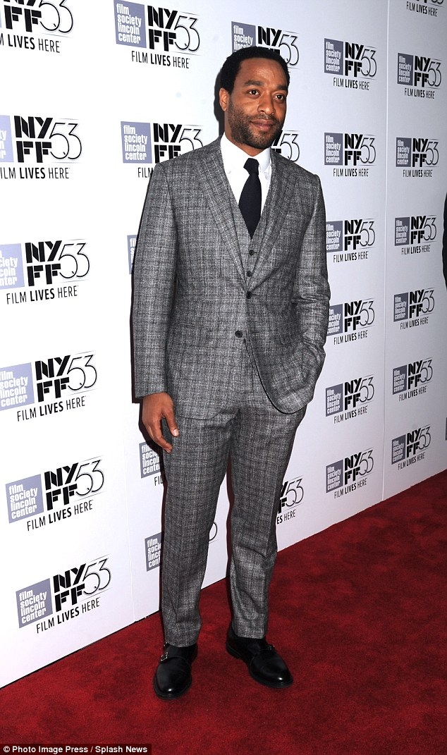 Suited and booted: The star looked incredibly dapper in a grey checked Thom Sweeney ensemble for the occasion
