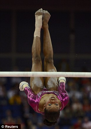 Gabrielle Douglas of the U.S. competes in the uneven bars