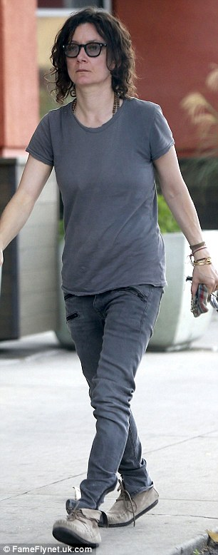 Keeping it casual: The Talk co-host embraced her casual side with a grey top, faded jeans, and suede shoes