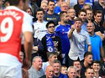 19 September 2015 - Barclays Premier League - Chelsea v Arsenal - A Chelsea fans shouts abuse and gestures at Santi Cazorla of Arsenal - Photo: Marc Atkins / Offside.