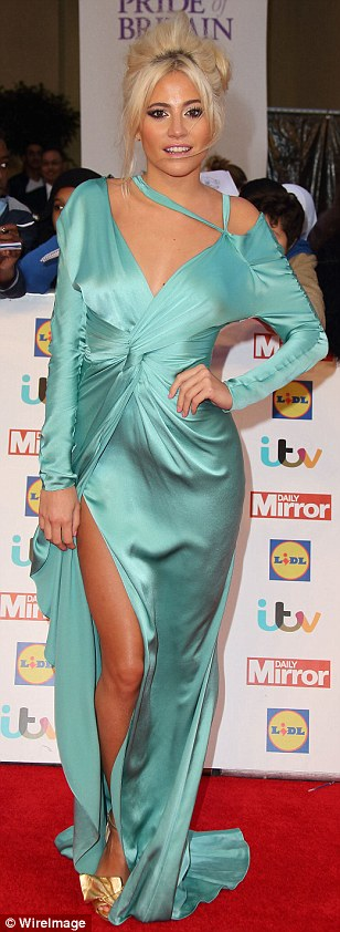 Daring to bare:Pixie Lott put on a leggy display in a bold thigh-high slit satin gown