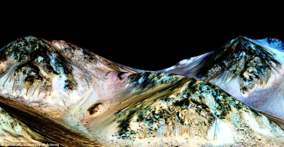By studying the infrared wavelengths from these flows, the researchers believe the marks are likely made by flowing water due to the presence of hydrated salts. This is the first evidence of its kind to be found on another planet and could even suggest there is an ocean beneath Mars' icy desert surface (Hale crater pictured)