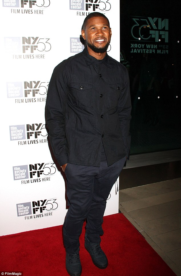 Chill: Usher arrived in a black blouse and navy trousers which he teamed with black shoes